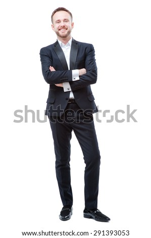 Confidence and charisma. Full length of smiling young bearded man in formalwear keeping arms crossed and looking at camera against white background - stock photo