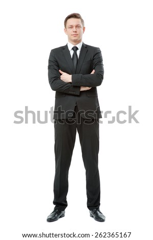 Confidence and charisma. Full length of smiling young businessman in suit and tie keeping arms crossed and looking at camera isolated on white background - stock photo