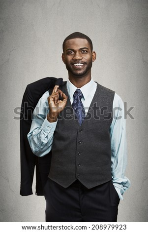 Confidence, charisma. Closeup portrait Cheerful young African man in full suit holding jacket over shoulder looking at camera isolated grey wall background. Human face expression emotion body language - stock photo