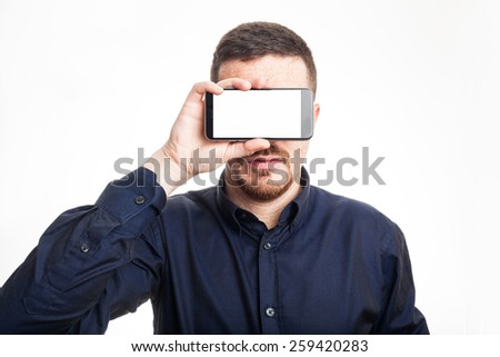 Confident Adult Man Covering his Face with a Mobile Phone White Background - stock photo