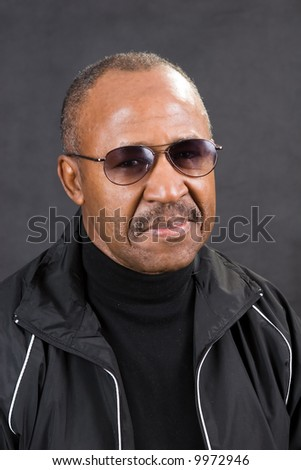 confident african american man retirement age wearing glasses - stock photo