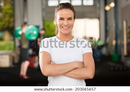 Confident and beautiful woman at fitness gym - stock photo