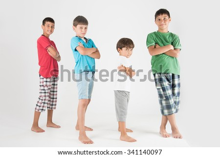 Confident and happy little models posing in full body shot - stock photo
