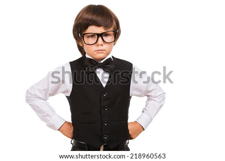 Confident and intelligence. Portrait of serious young boy in bow tie looking at camera while isolated on white - stock photo