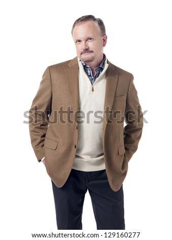 Confident and smiling old businessman with hand on his pocket - stock photo