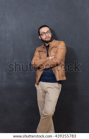 Confident and well-dressed. Handsome young man in smart casual wear looking at camera while standing against grey background - stock photo