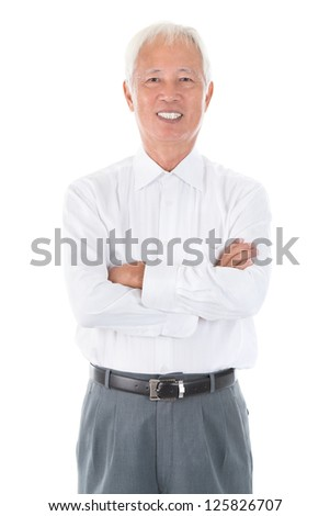 Confident arms crossed senior adult Asian Chinese businessman standing isolated white background - stock photo