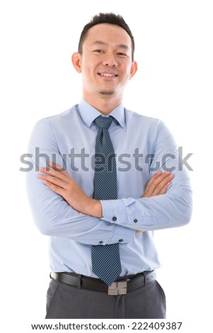 Confident  Asian business man smiling, standing isolated over white background. - stock photo