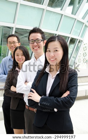 Confident asian business team - stock photo