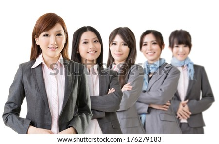 Confident Asian business team, select focus on first woman. - stock photo