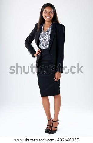 Confident asian businessperson smiling in studio, full length portrait - stock photo