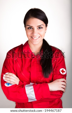 Confident beautiful paramedic  woman in uniform with stethoscope on white background - stock photo