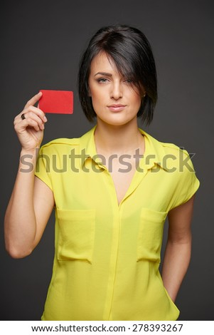 Confident beautiful woman showing blank credit card - stock photo