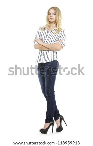 Confident blonde woman in blouse clothing, standing with hands folded against white background - stock photo