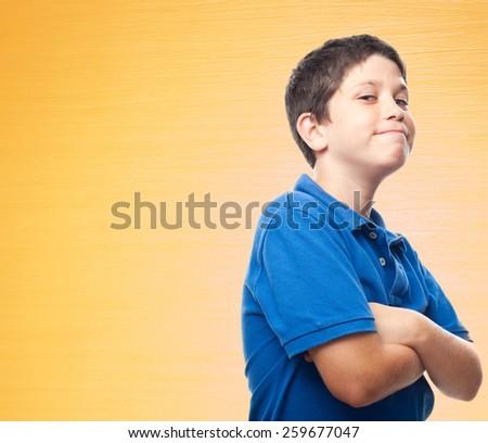 confident boy orange background - stock photo