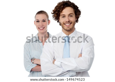 Confident business colleagues posing arms crossed - stock photo