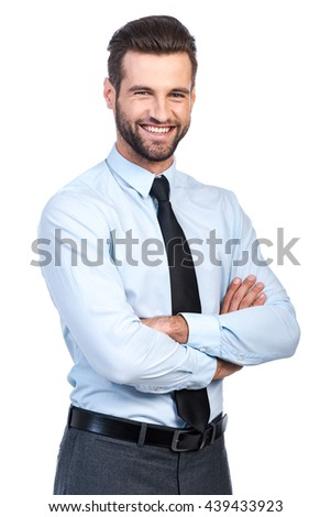 Confident business expert. Confident young handsome man in shirt and tie keeping arms crossed and smiling while standing against white background  - stock photo