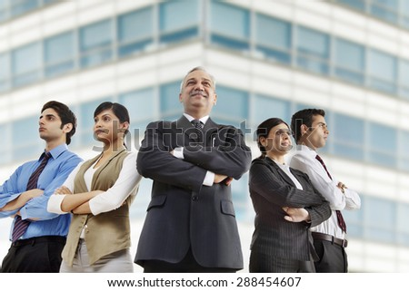 Confident business group standing together outdoors - stock photo