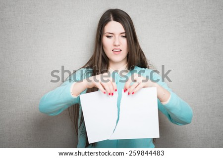 Confident business lady. Furious young woman tearing up paper  - stock photo