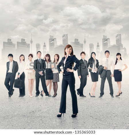 Confident business manager with her business team stand on road in modern city. - stock photo