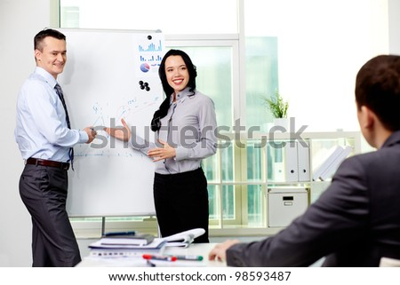 Confident business partners carrying out presentation of business plan to manager - stock photo