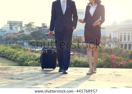 Confident business partners walking outdoors and talking - stock photo