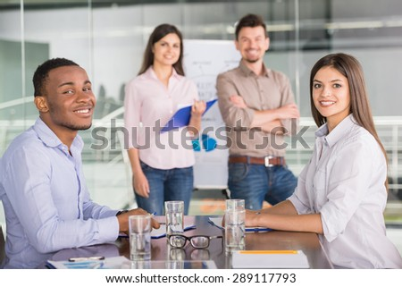 Confident business people presenting new business strategy at conference room to partners. - stock photo