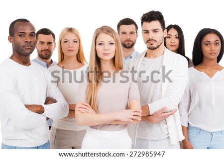 Confident business team. Group of confident multi-ethnic group of people in smart casual wear looking at camera while standing against white background - stock photo