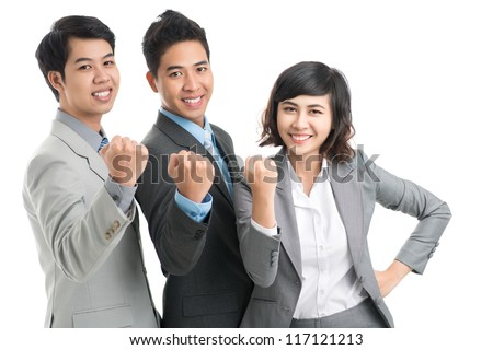 Confident business team showing fist at camera - stock photo
