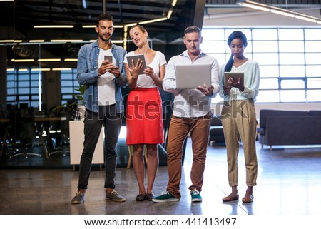 Confident business team standing in modern studio - stock photo