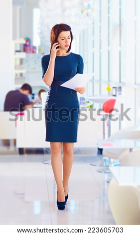 confident business woman busy with work - stock photo
