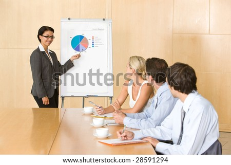 confident business woman giving presentation to colleauges - stock photo