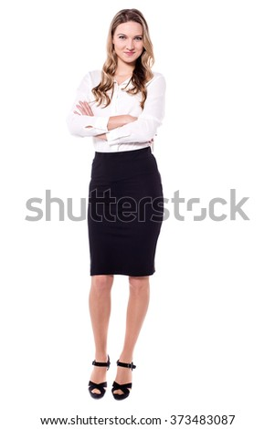 Confident business woman isolated on white with crossed arms - stock photo