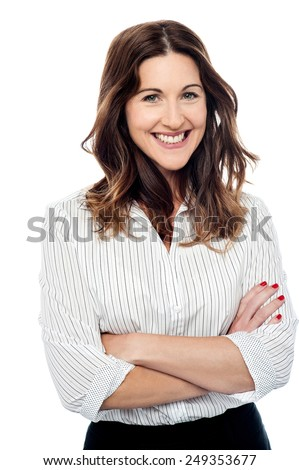 Confident business woman keeping arms crossed - stock photo