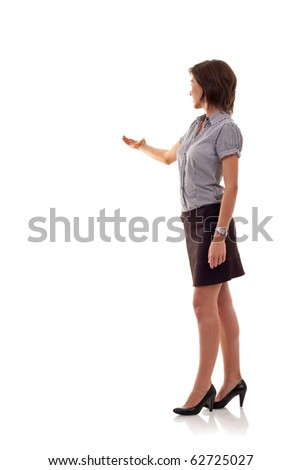 Confident business woman presenting something isolated over a white background, a lot of copyspace - stock photo