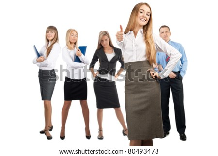 Confident business woman showing thumbs up with her colleagues standing in the background. Isolated on white - stock photo