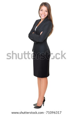 Confident business woman standing full length in black suit. Businesswoman or real estate agent isolated on white background. - stock photo