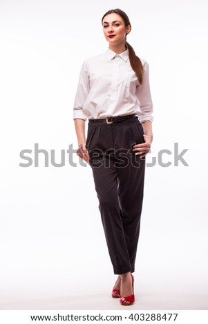 Confident business woman standing full length on white background. - stock photo