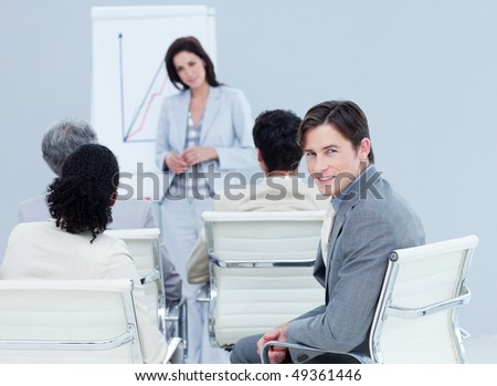 Confident businessman at a presentation with his colleagues - stock photo