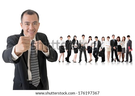 Confident businessman fighting and standing in front of his team on studio white background. - stock photo