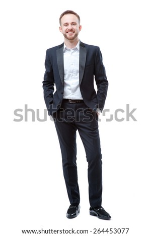 Confident businessman. Full length of handsome young bearded man holding hands in pockets and looking at camera isolated on white - stock photo