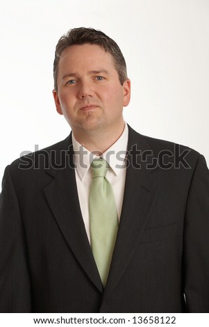 Confident businessman in suit on white background - stock photo