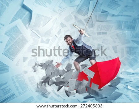 Confident businessman is surfing on red umbrella - stock photo
