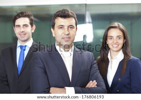 Confident businessman leader on the foreground of his team - stock photo