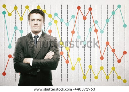 Confident businessman on colorful business chart background - stock photo