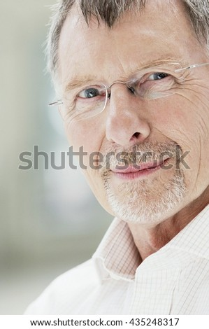 Confident Businessman portrait in business ambience - stock photo