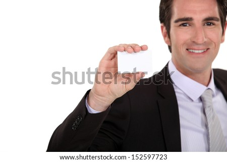 Confident businessman presenting card - stock photo