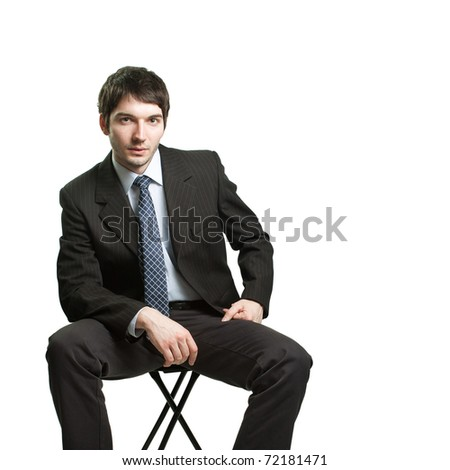 Confident businessman sitting on chair over white - stock photo