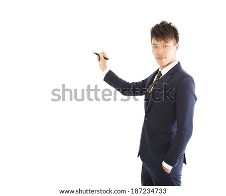 confident businessman standing and holding a pencil  - stock photo