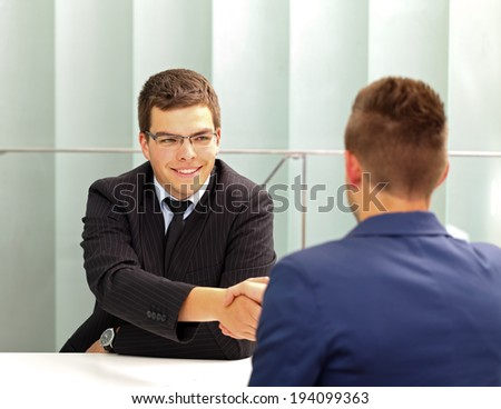 Confident businessman talking with his client in the office - stock photo